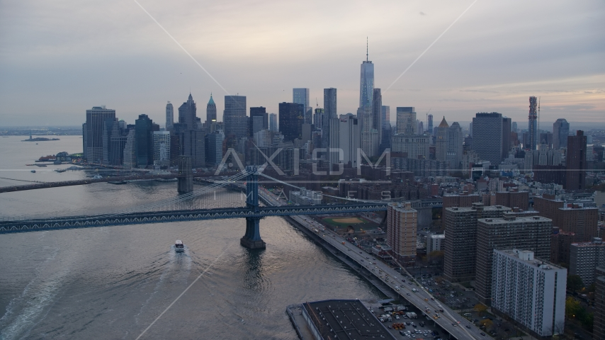 The Manhattan Bridge near the Lower Manhattan skyline at sunset in New York City Aerial Stock Photos AX121_028.0000216F | Axiom Images