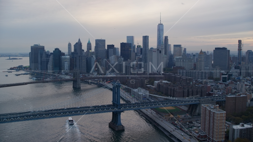 The Brooklyn Bridge, Manhattan Bridge, and Lower Manhattan at sunset in New York City Aerial Stock Photo AX121_029.0000120F | Axiom Images