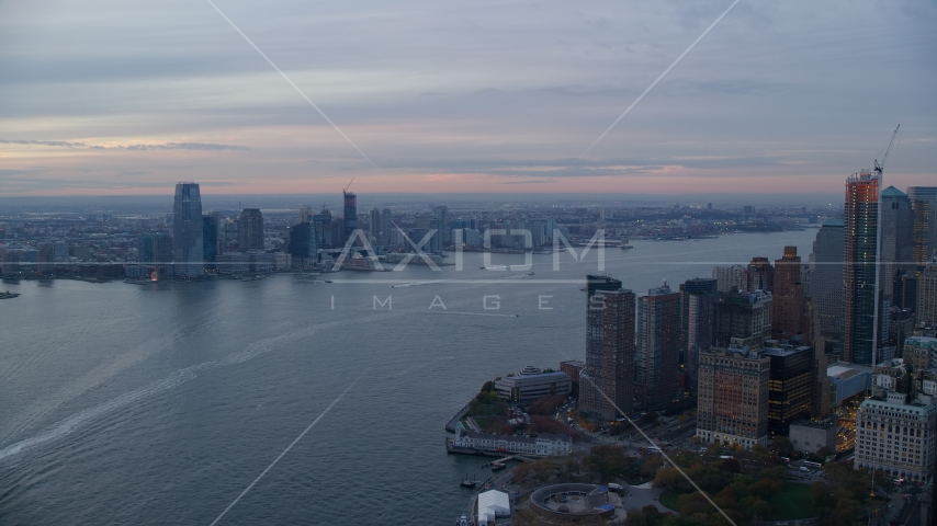 Downtown Jersey City, New Jersey at sunset seen across the Hudson River Aerial Stock Photo AX121_035.0000185F | Axiom Images