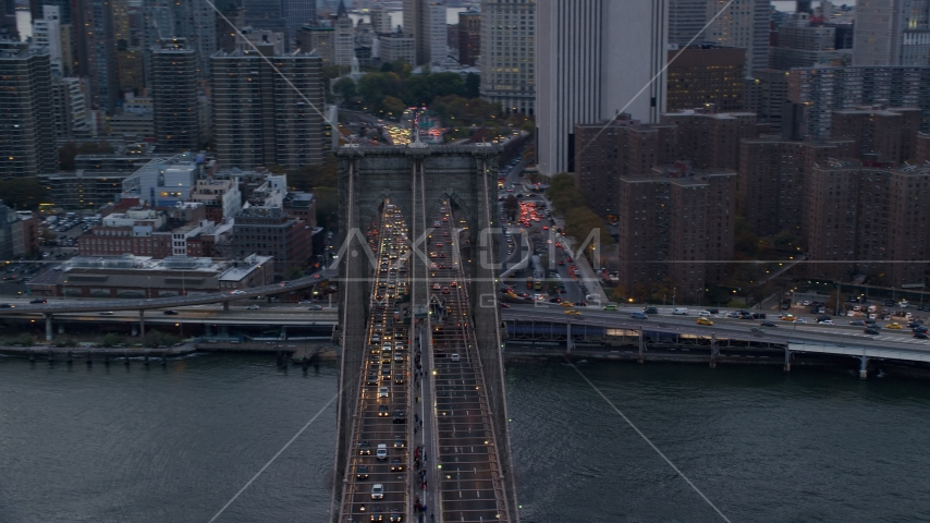 Heavy traffic on the Brooklyn Bridge at sunset in New York City Aerial Stock Photo AX121_040.0000074F | Axiom Images