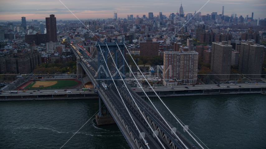 The Manhattan Bridge at sunset in New York City Aerial Stock Photo AX121_041.0000041F | Axiom Images