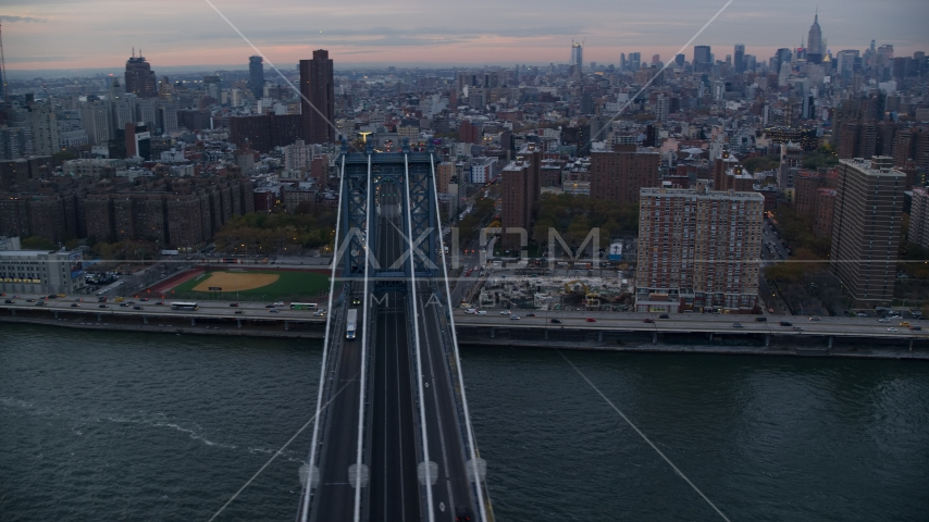 Light traffic on the Manhattan Bridge at sunset in New York City Aerial Stock Photos | AX121_041.0000083F