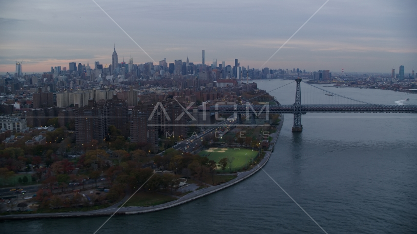Lower East Side projects, the Williamsburg Bridge, and Midtown skyline at sunset in New York City Aerial Stock Photos | AX121_044.0000009F