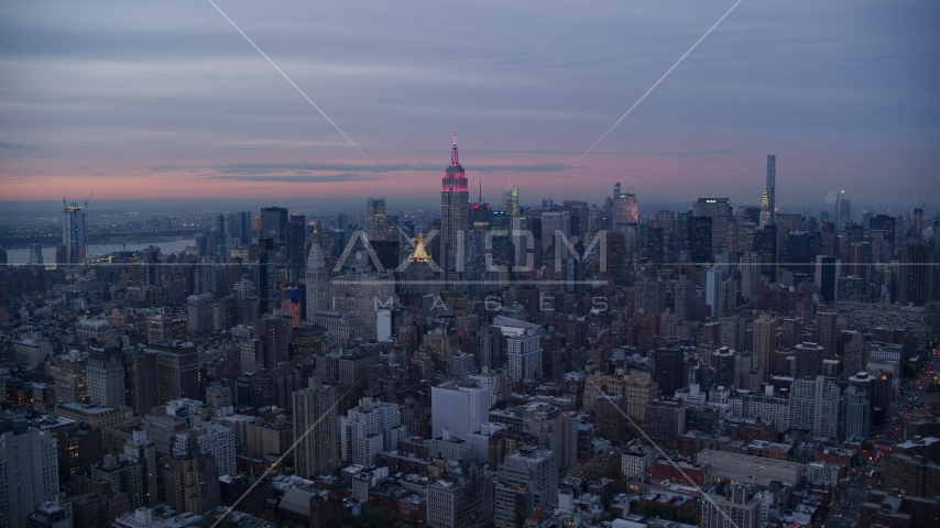 Empire State Building and Midtown skyscrapers at sunset in New York City Aerial Stock Photos | AX121_078.0000126F