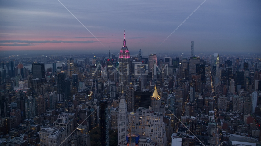 The Empire State Building and Midtown Manhattan skyscrapers at sunset in New York City Aerial Stock Photos | AX121_081.0000000F