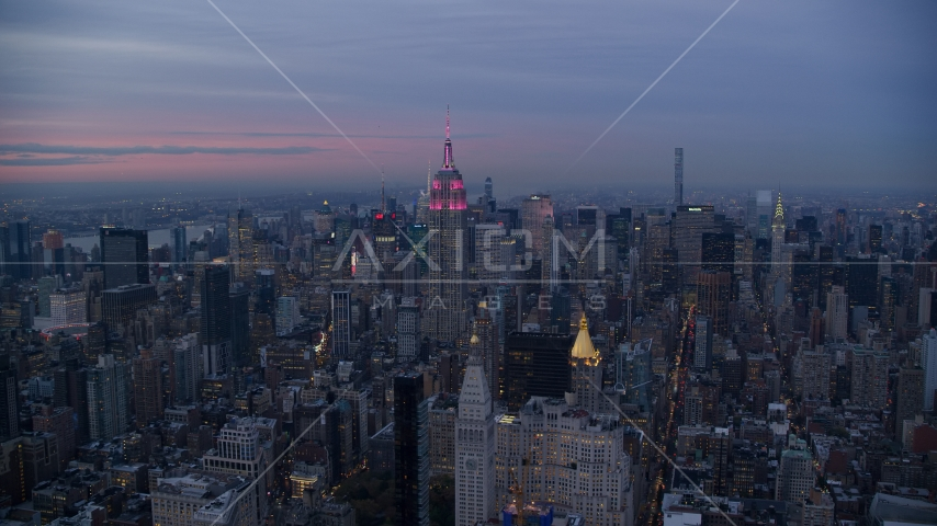 The Empire State Building and Midtown high-rises at sunset in New York City Aerial Stock Photos | AX121_081.0000054F