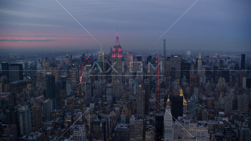 Empire State Building with pink lights and Midtown high-rises at Sunset in New York City Aerial Stock Photos | AX121_081.0000239F