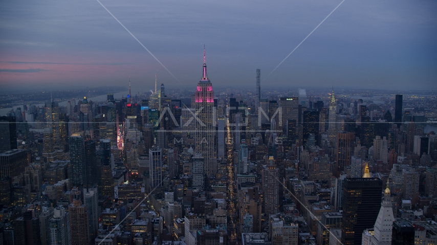 A view of the Empire State Building in Midtown at sunset in New York City Aerial Stock Photos AX121_082.0000155F | Axiom Images