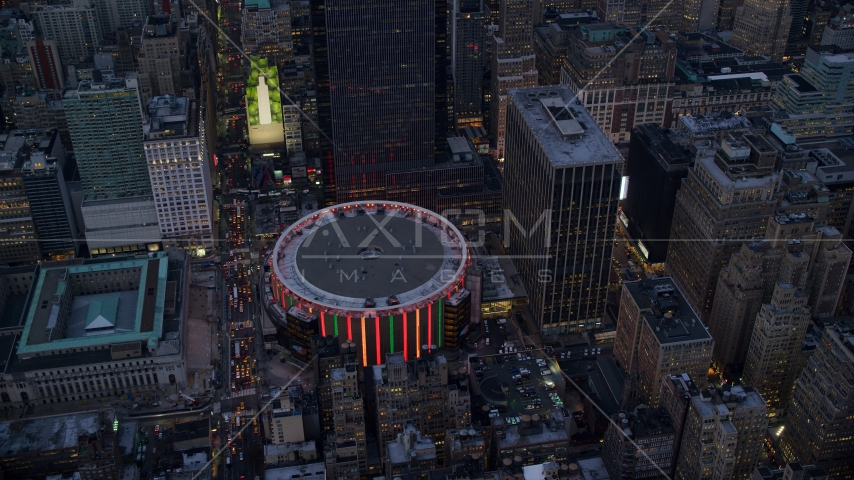 The Madison Square Garden arena at sunset in Midtown, New York City Aerial Stock Photos | AX121_085.0000087F