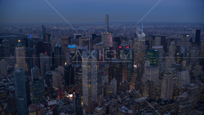A group of Midtown skyscrapers at sunset in New York City Aerial Stock Photos | AX121_087.0000092F