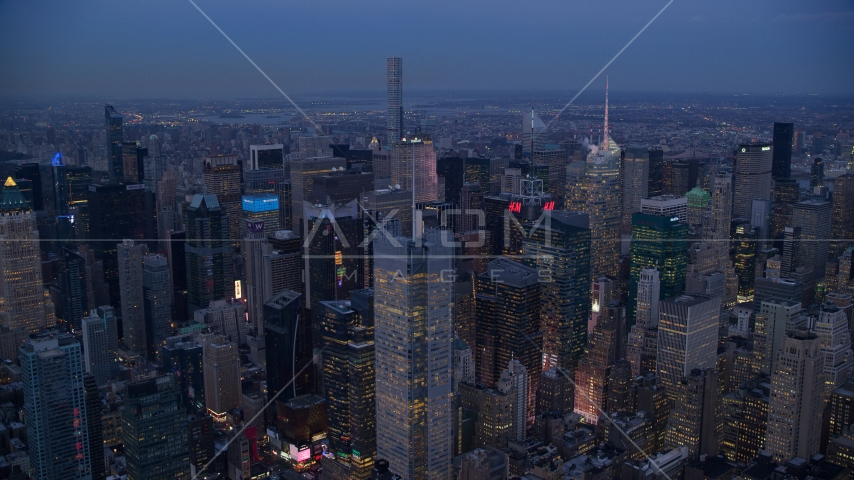 A group of tall Midtown skyscrapers at sunset in New York City Aerial Stock Photos | AX121_087.0000257F