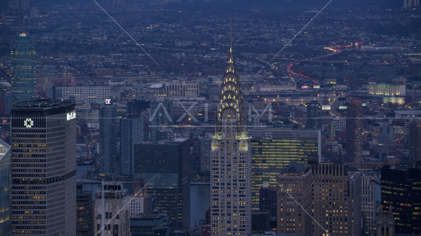 Top of Chrysler Building at sunset in Midtown, New York City Aerial Stock Photos AX121_089.0000062F | Axiom Images