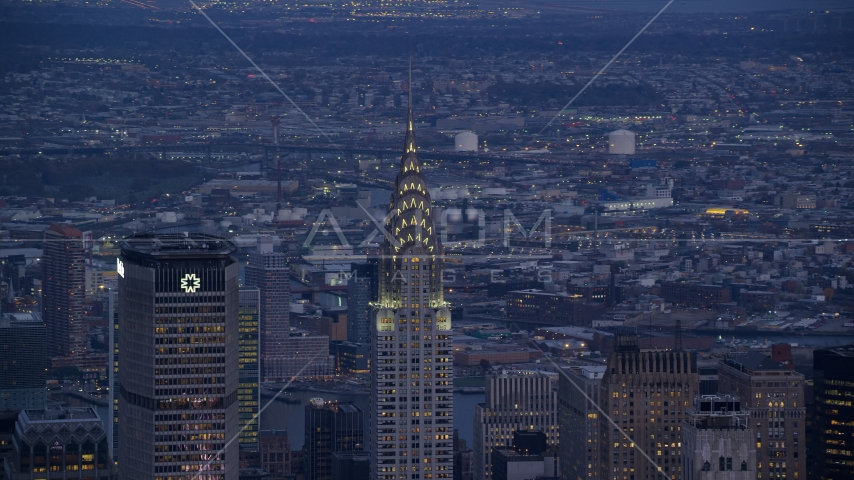 The tops of the MetLife and Chrysler Building in Midtown at sunset in New York City Aerial Stock Photos | AX121_090.0000279F