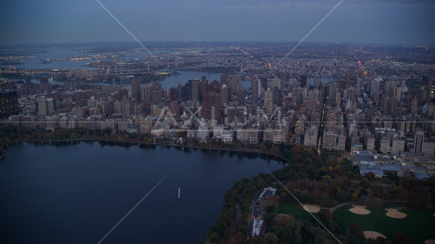 Upper East Side apartment buildings near Central Park at sunset, New York City Aerial Stock Photos | AX121_096.0000100F