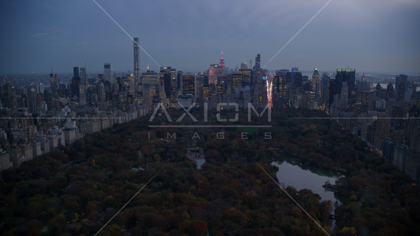 Midtown skyscrapers and The Lake in Central Park at sunset, New York City Aerial Stock Photo AX121_098.0000102F | Axiom Images