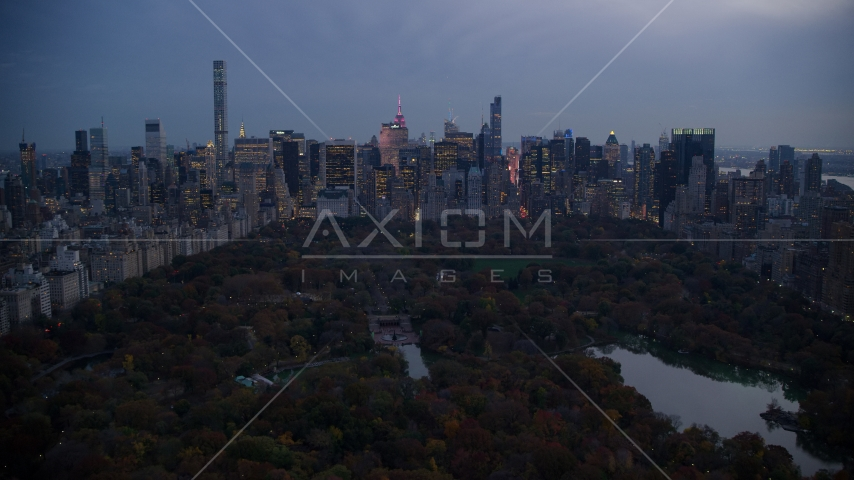Midtown Manhattan skyscrapers and The Lake in Central Park at sunset, New York City Aerial Stock Photos | AX121_098.0000265F