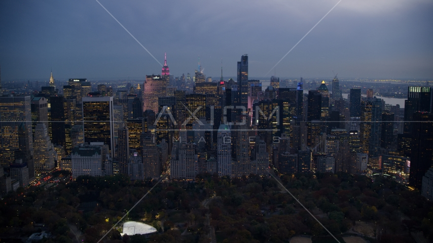 Midtown skyscrapers by Central Park at sunset in New York City Aerial Stock Photos | AX121_100.0000241F