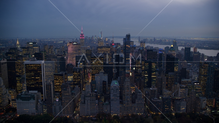 Tall Midtown Manhattan skyscrapers at sunset in New York City Aerial Stock Photos | AX121_101.0000104F