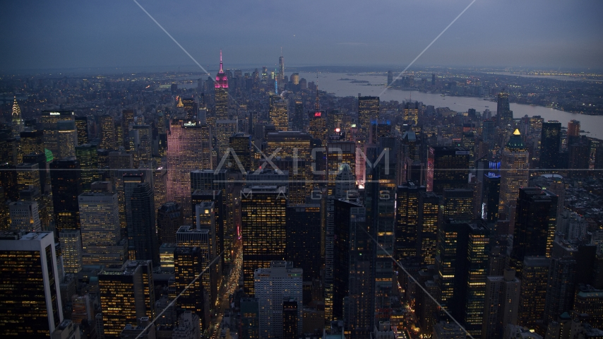 Midtown skyscrapers near Times Square at sunset in New York City Aerial Stock Photo AX121_102.0000049F | Axiom Images
