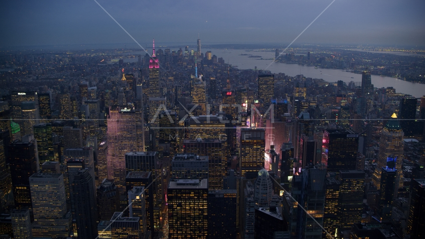 Midtown skyscrapers and bright lights of Times Square at sunset in New York City Aerial Stock Photos | AX121_102.0000244F