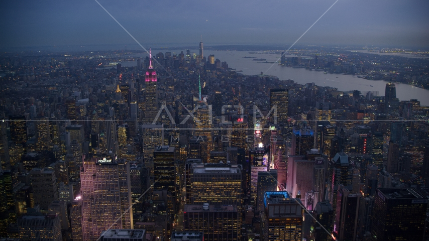 Times Square and Midtown skyscrapers with Lower Manhattan in the background at sunset, New York City Aerial Stock Photos | AX121_103.0000219F