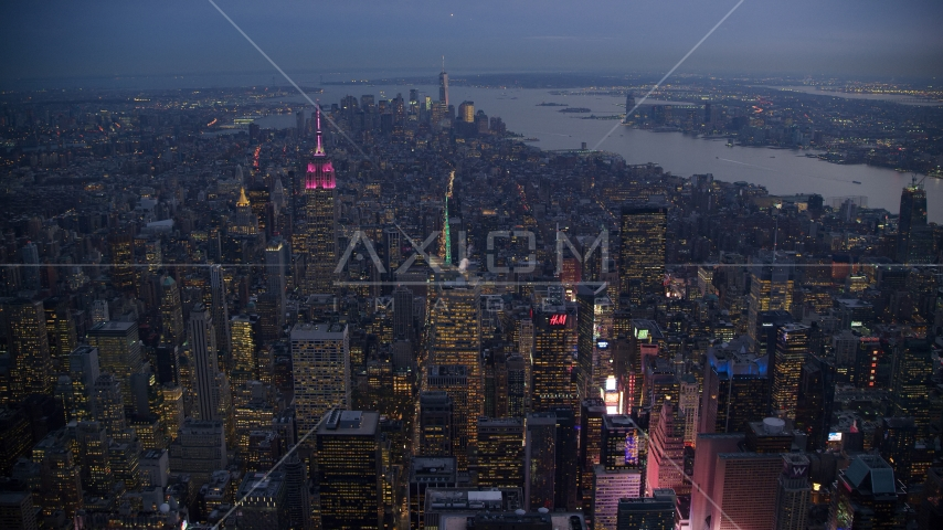 Lower Manhattan seen from Midtown near Times Square at sunset in New York City Aerial Stock Photos | AX121_104.0000231F