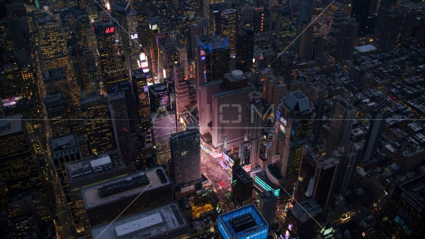 Bright lights of Times Square at sunset in Midtown Manhattan, New York City Aerial Stock Photos | AX121_105.0000077F