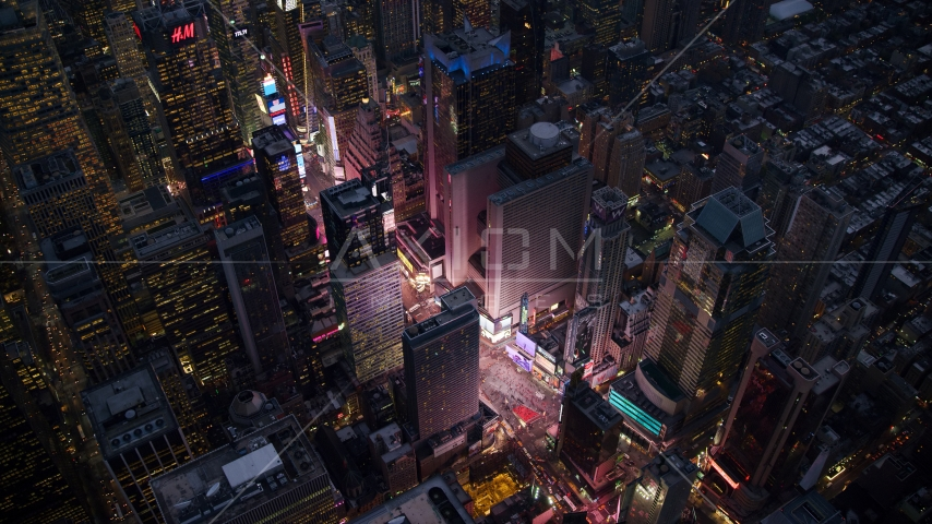 The bright lights and video screens of Times Square at sunset in Midtown, New York City Aerial Stock Photos AX121_105.0000243F | Axiom Images