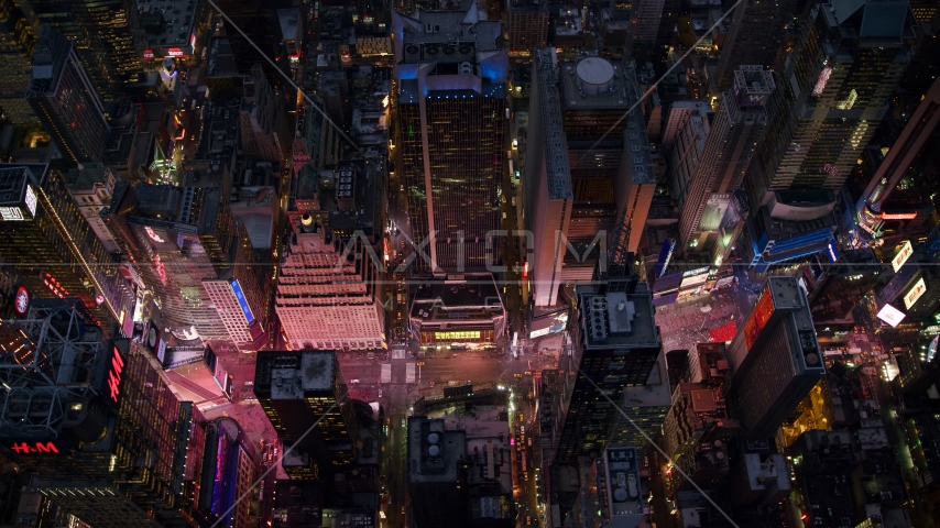 Looking down on Times Square at Sunset in Midtown Manhattan, New York City Aerial Stock Photos | AX121_107.0000048F