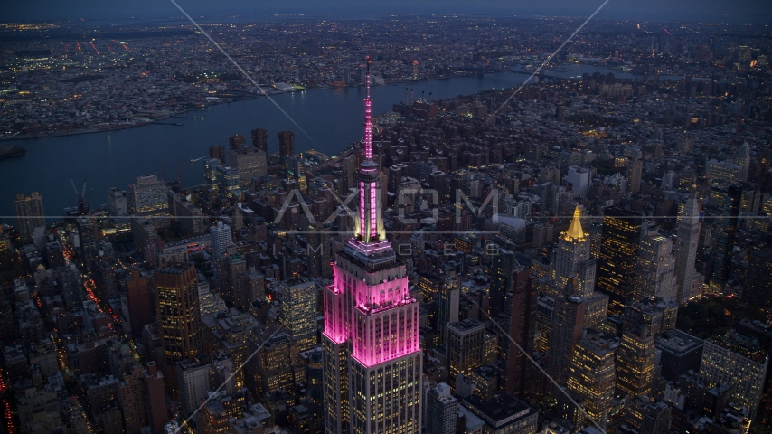 The top of Empire State Building at sunset in Midtown, New York City Aerial Stock Photos | AX121_108.0000073F