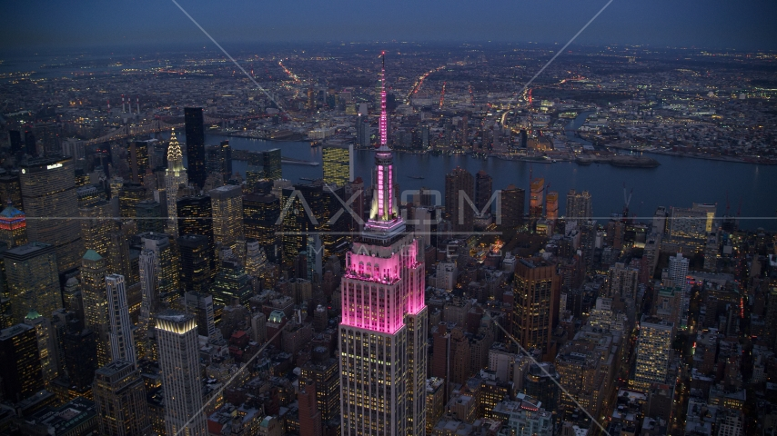 The Empire State Building with pink lights at sunset in Midtown, New York City Aerial Stock Photos AX121_108.0000414F | Axiom Images