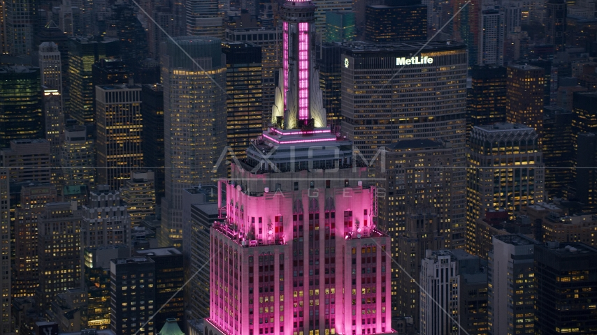 Pink lights on the Empire State Building at sunset in Midtown Manhattan, New York City Aerial Stock Photos | AX121_109.0000359F