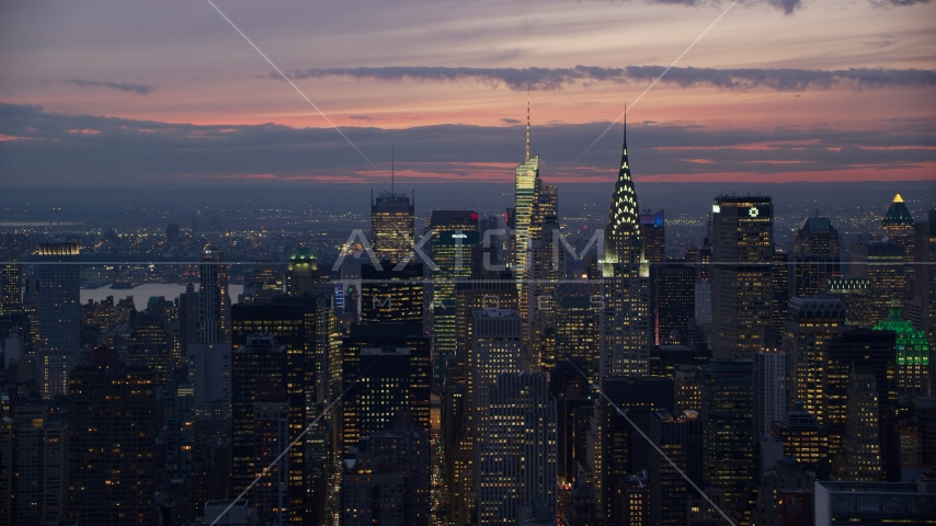 The Chrysler Building and Midtown Manhattan skyscrapers at sunset in New York City Aerial Stock Photos | AX121_116.0000116F