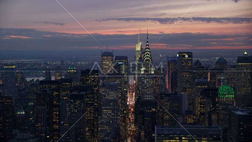 Chrysler Building in front of Midtown skyscrapers at sunset, New York City Aerial Stock Photos | AX121_116.0000185F