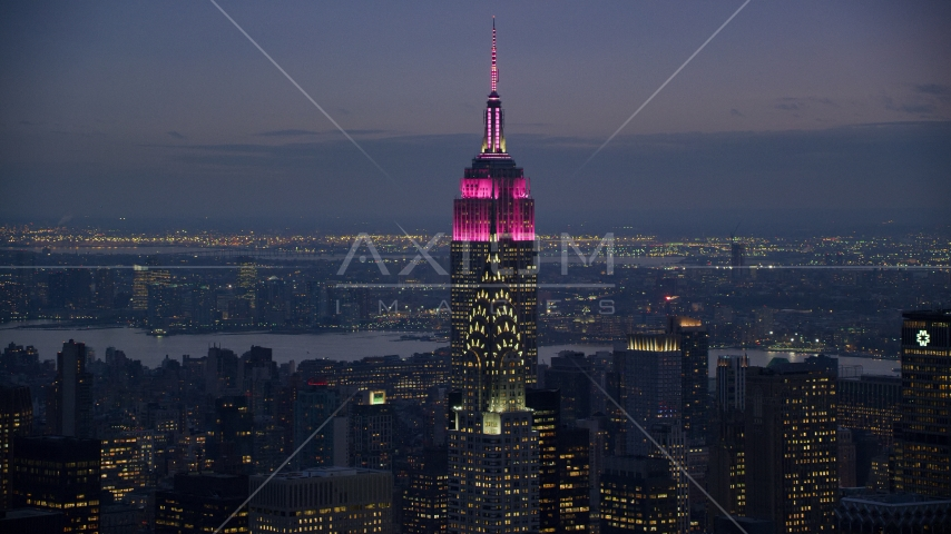 The Empire State Building behind the Chrysler Building at sunset in Midtown Manhattan, New York City Aerial Stock Photos | AX121_122.0000177F
