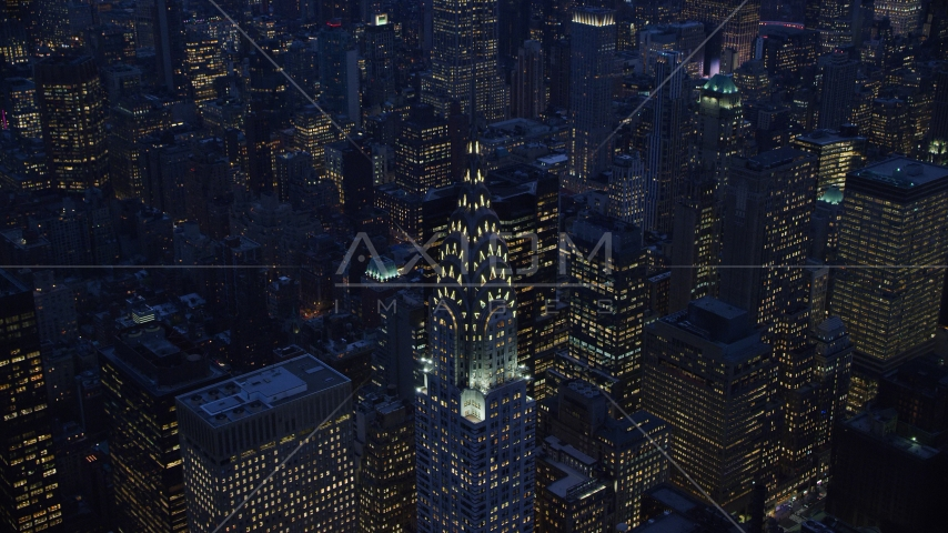 A view of the top of the Chrysler Building at sunset in the Midtown area of New York City Aerial Stock Photo AX121_125.0000243F | Axiom Images