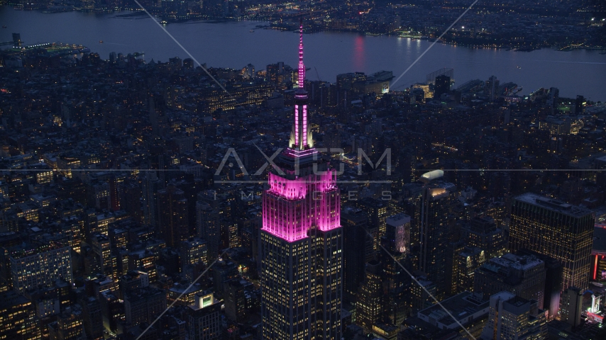 The Empire State Building with pink lights at sunset in Midtown, New York City Aerial Stock Photos | AX121_127.0000132F