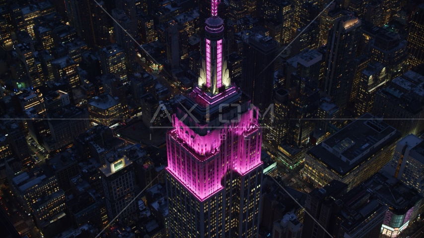 Top levels of the Empire State Building at sunset in Midtown, New York City Aerial Stock Photos | AX121_128.0000131F