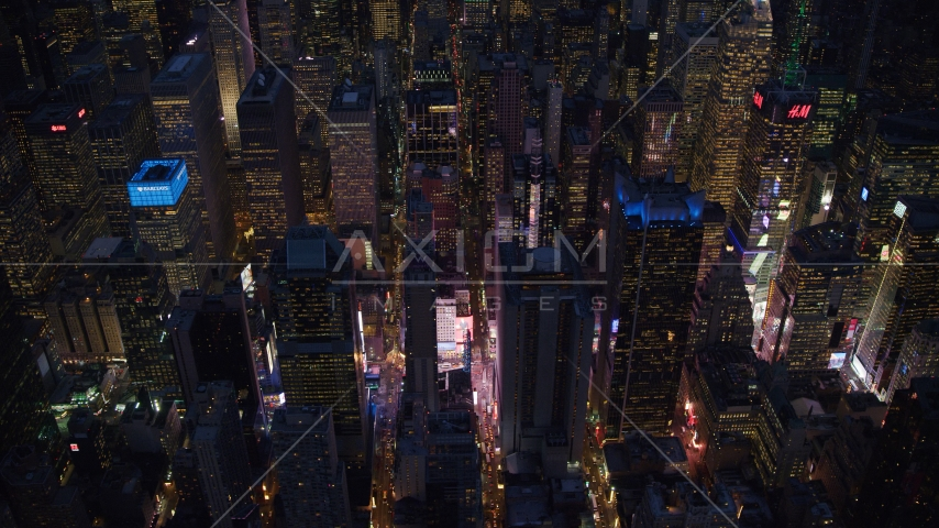 Midtown skyscrapers around Times Square at night, New York City Aerial Stock Photos | AX121_133.0000007F