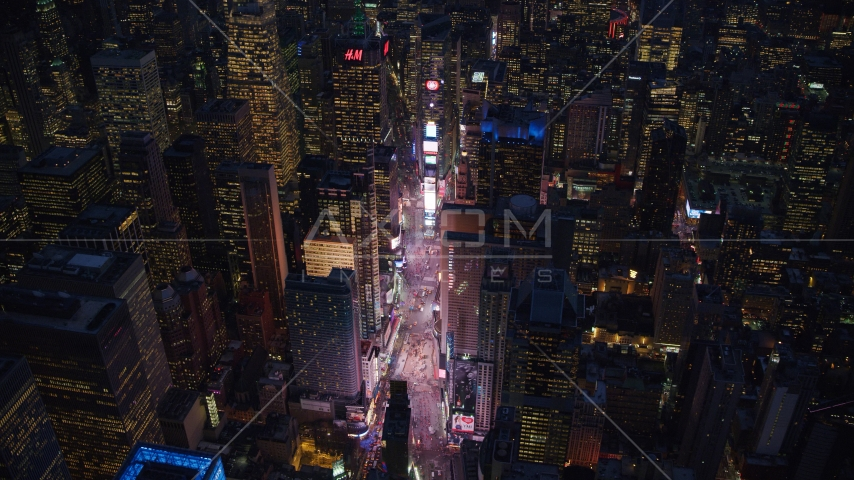 Times Square at night in Midtown Manhattan, New York City Aerial Stock Photos | AX121_134.0000303F