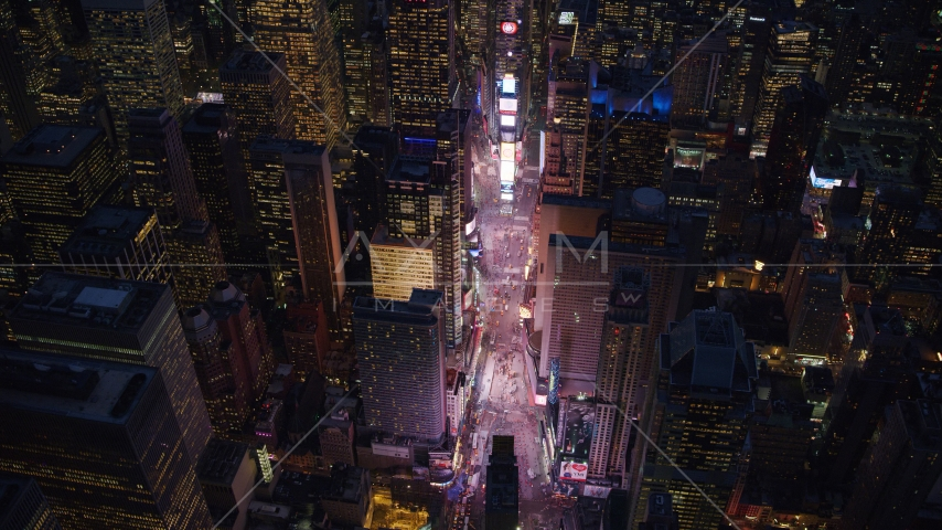 The bright lights of Times Square at night in Midtown, New York City Aerial Stock Photos | AX121_135.0000081F