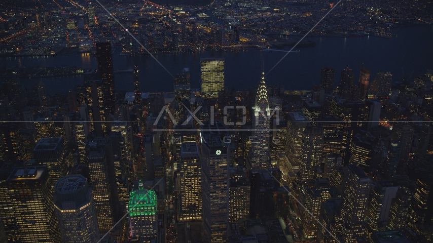 The UN and Chrysler Building and Midtown skyscrapers at night in New York City Aerial Stock Photos | AX121_137.0000031F