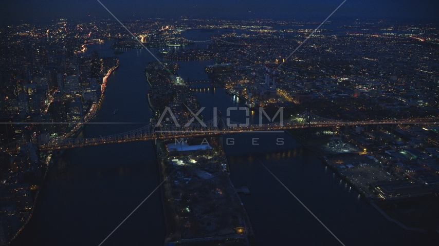 The Queensboro Bridge and Roosevelt Island at night in New York City Aerial Stock Photos AX121_141.0000095F