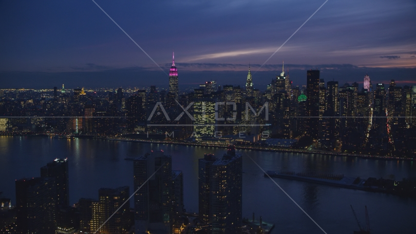 The UN Building and Midtown seen from Queens at night in New York City Aerial Stock Photos | AX121_143.0000082F