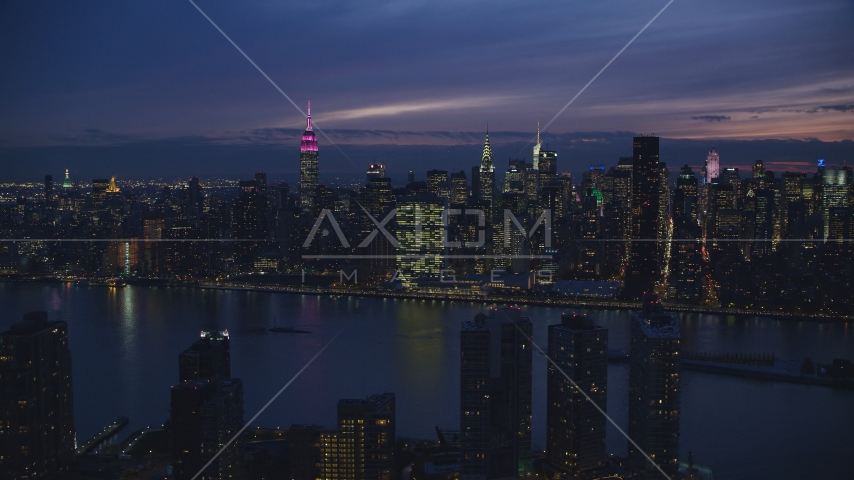Midtown Manhattan seen from Queens at night in New York City Aerial Stock Photos | AX121_143.0000231F