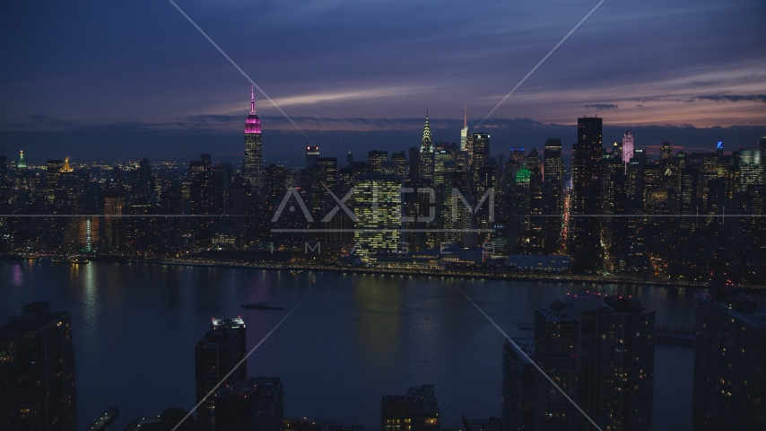 Midtown Manhattan across the East River at night in New York City Aerial Stock Photos | AX121_144.0000032F