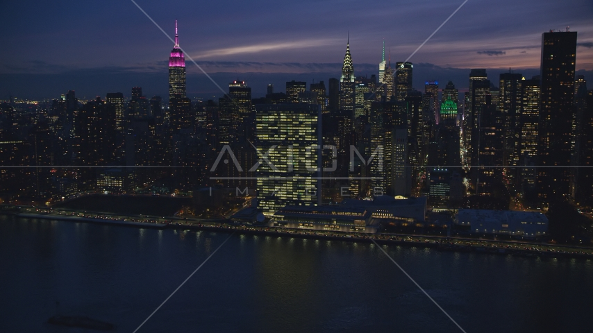 The UN Building in Midtown at night in New York City Aerial Stock Photos | AX121_145.0000199F