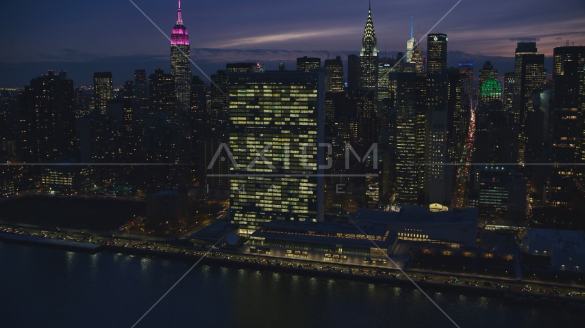 The United Nations building at night in New York City Aerial Stock Photos | AX121_146.0000110F