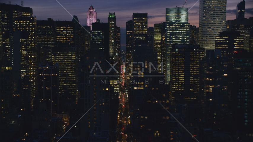 Midtown city canyon at night in New York City Aerial Stock Photos | AX121_147.0000052F