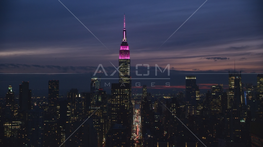 Empire State Building at night in Midtown Manhattan, NYC Aerial Stock Photos | AX121_152.0000242F